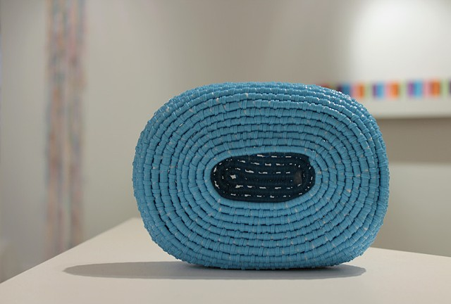 contemporary coiled basket sculpture made of blue plastic lacing by Jose Santiago Perez