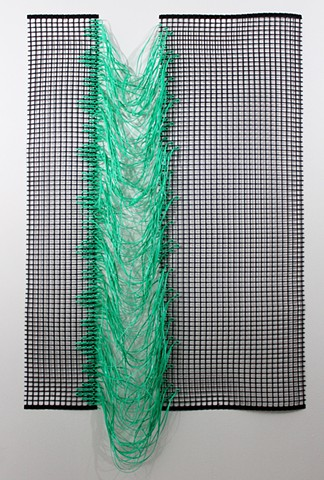 green plastic wall hanging by Jose Santiago Perez