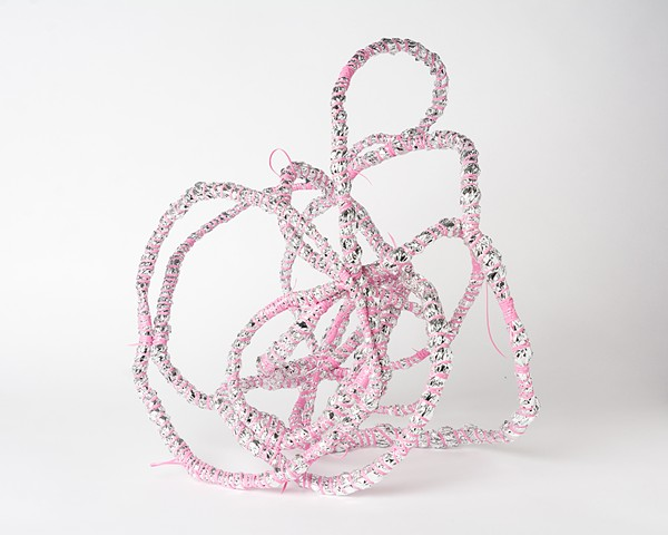 pink coiled emergency blanket sculpture by Jose Santiago Perez