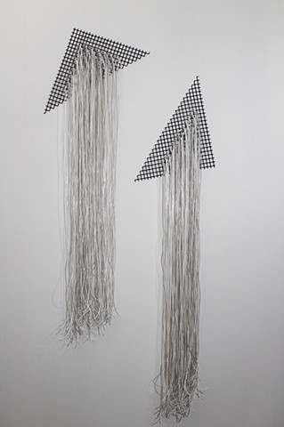two white plastic wall hangings by Jose Santiago Perez
