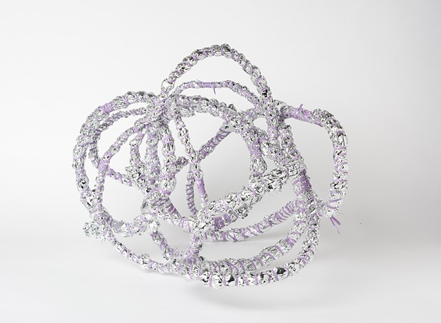 abstract basket made of lavender plastic lacing and emergency blankets by Jose Santiago Perez