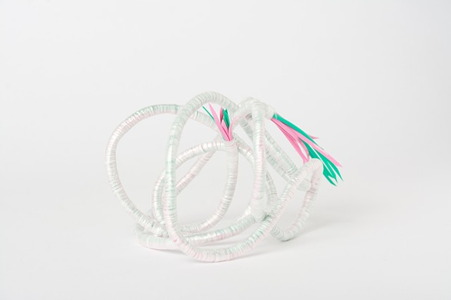 abstract plastic basket in pink and mint by Jose Santiago Perez