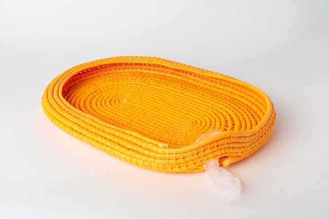 orange coiled plastic sculpture by Jose Santiago Perez