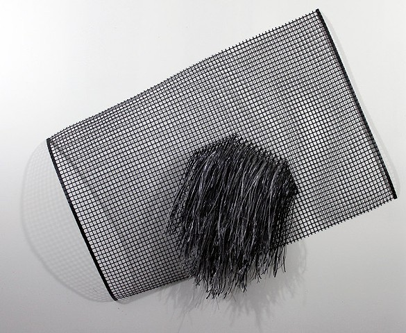 black plastic wall hanging by Jose Santiago Perez