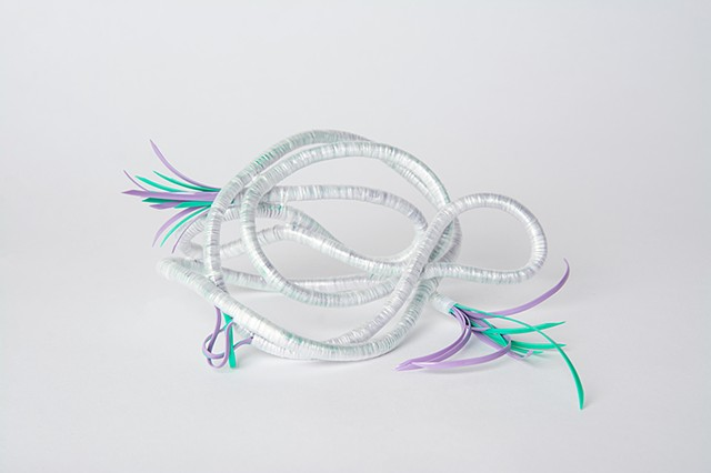 abstract plastic basket in lavender and mint by Jose Santiago Perez