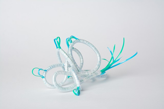 abstract plastic basket in mint and baby blue by Jose Santiago Perez