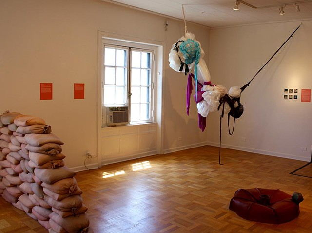 Installation view of plastic and fabric performance based sculpture with photo documentation by Jose Santiago Perez for group show Soft Sculpture at International Museum of Surgical Science Chicago