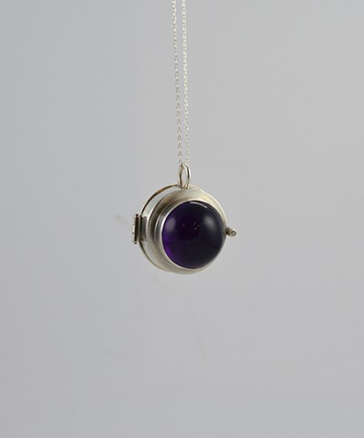Amethyst, diamond, and sterling silver locket