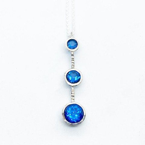Ice blue topaz and sterling silver pendant on sterling silver chain