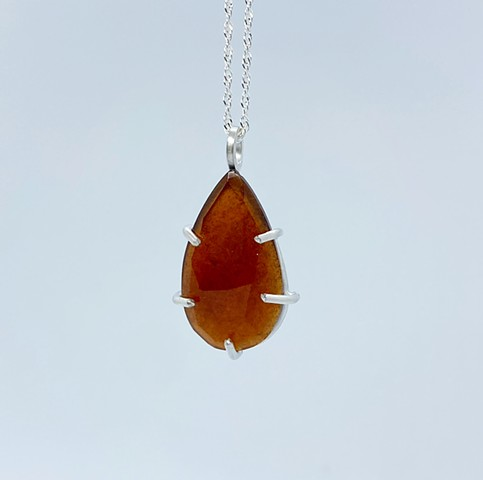 Prong set Hessonite garnet with sterling silver