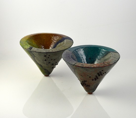Set of two hollow constructed, enameled, copper vessles.