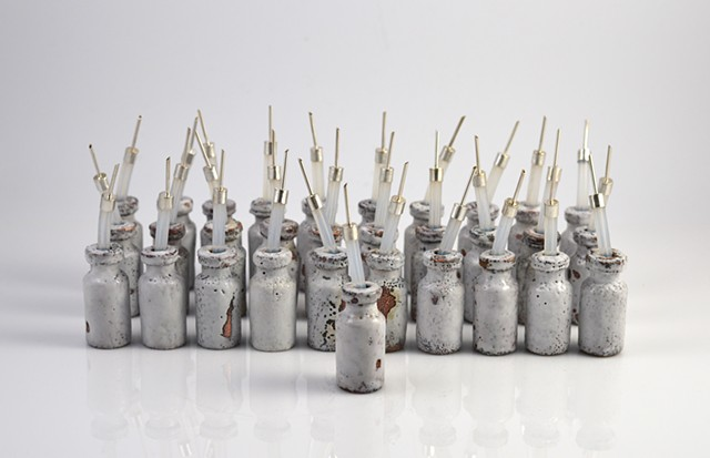 31 Enameled copper bottles with sterling silver caps by Erin Rice