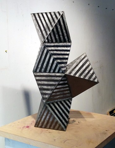 Geometric sculpture in monochromatic Graphite stripes