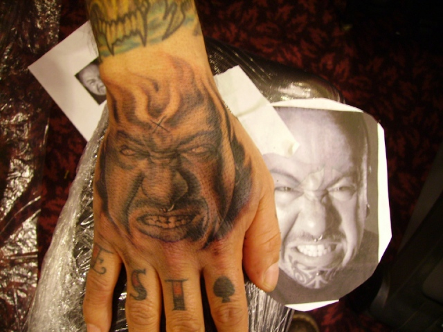 "Ron Meyers - Evil Portrait of Tattoo Artist Manuel Vega on his hand. nothing like the pressure of tattooing a portrait on a ""Portrait Artist""!!!"