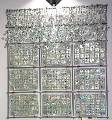 "fused glass panels arranged in a 26""x24"" grid"