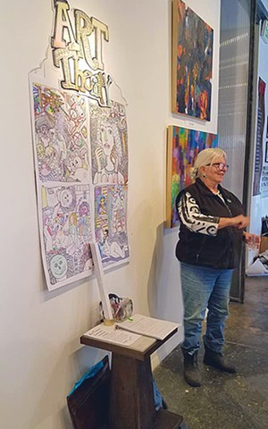 "Leslie Ann Aguillard with her interactive piece, ""Art Therapy"", Core Art Space"
