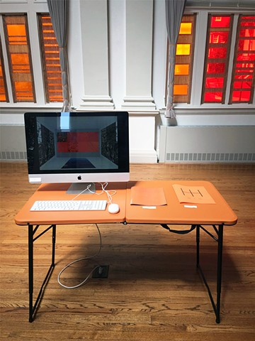Installation view of computer with animations and zines