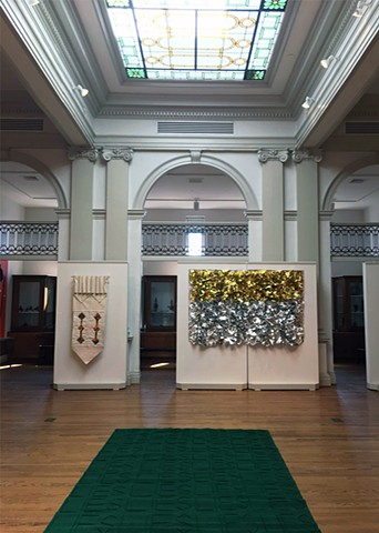 Installation view of Lies Above / Lies Hier with stained glass windows