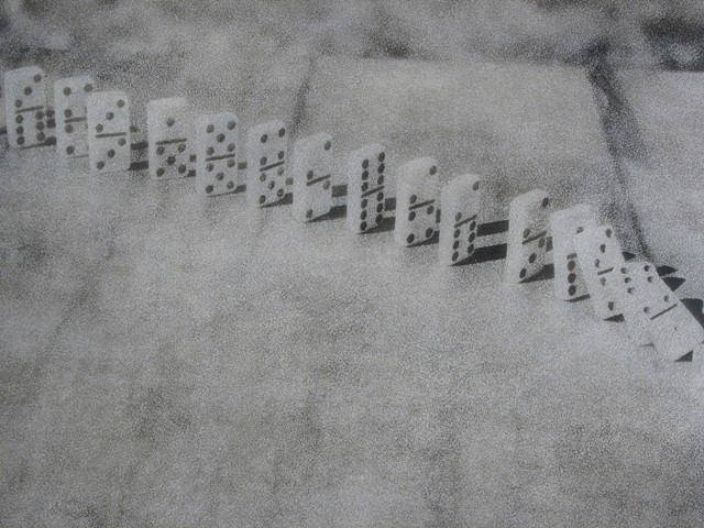 Photographic oil print of falling dominoes by E.E. Smith