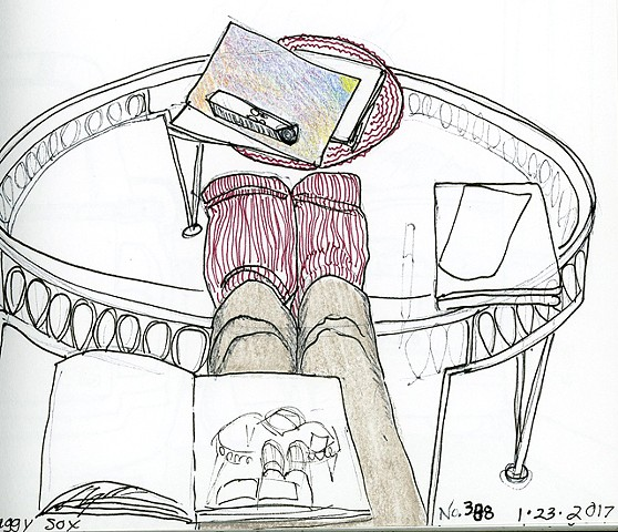 feet on coffee table and drawing