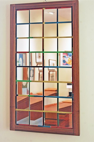 "Confetti series mirror, the reflection showing deconstructed dining room.  Walnut frame 20 x 43""."