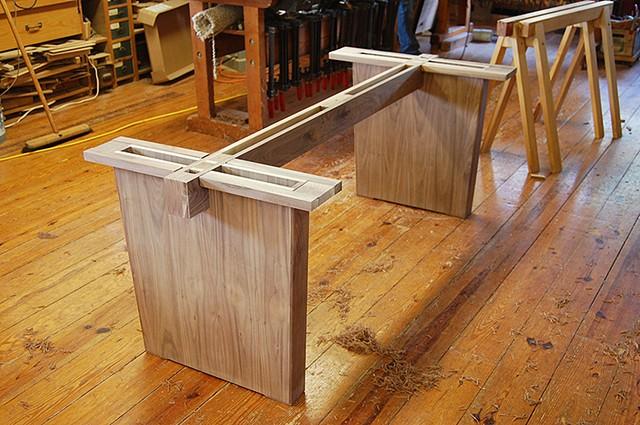 Slab table base design and details in walnut.