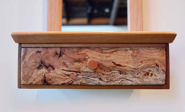 Detail of drawer for Top Hat Series cherry burl