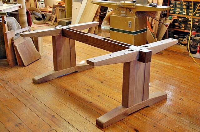 Base detail of Walnut Trestle Table.