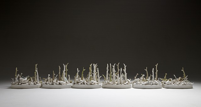 A sereis of glazed and cast porcelain sculptures that reference landscape and still life