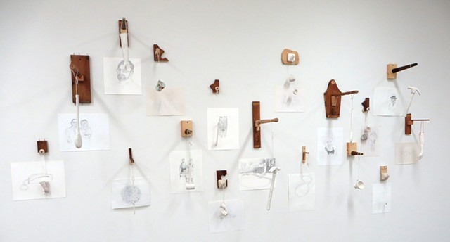 Wall installation incorporating found objects, thier hand built replicas in porcelain and drawings from photographs, displayed on wood and mixed media armatures, constructed from repurposed furniture parts.