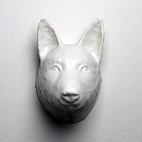 Cast porcelain wolf head.