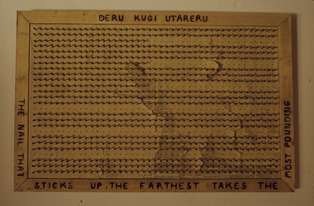 Deru Kugi Utareru, the nail that sticks up the farthest takes the most pounding, Kristine Aono, sculpture