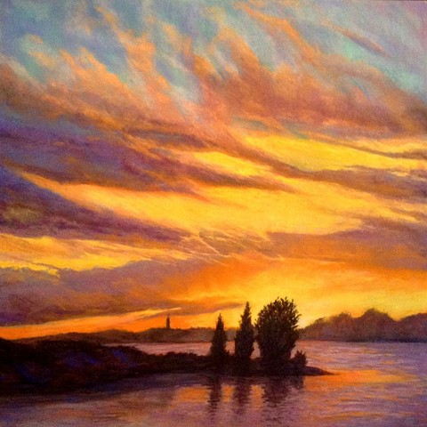 pastel landscape of a brilliant sunset over water