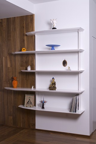hand shaped white lacquered custom shelving unit
