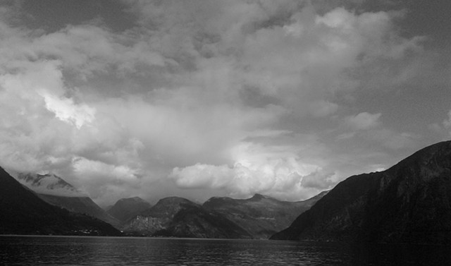 B&W photo of Nordic Fjord with clouds