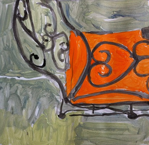 Chair with orange cushion