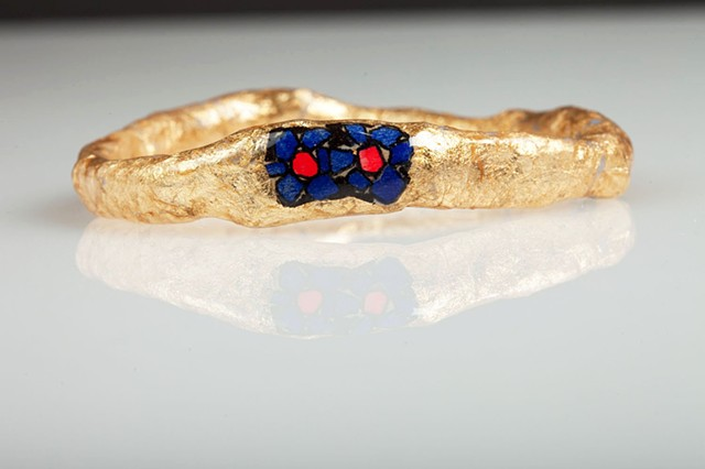 gold flower bangle in blue