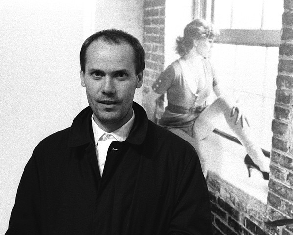 Richard Prince In Front Of Cindy Sherman's Work. 1984. 11in. x 14in. Silver Gelatin Print