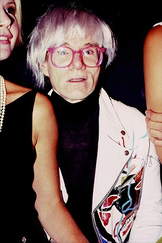 Andy Warhol at a party in 1985. 16in. x 20in. Chromogenic print.