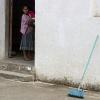 Guatemalan girl & blue broom