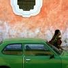 Guatemalan Woman w/Green Car