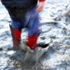 Red Rubber Boots in Puddle