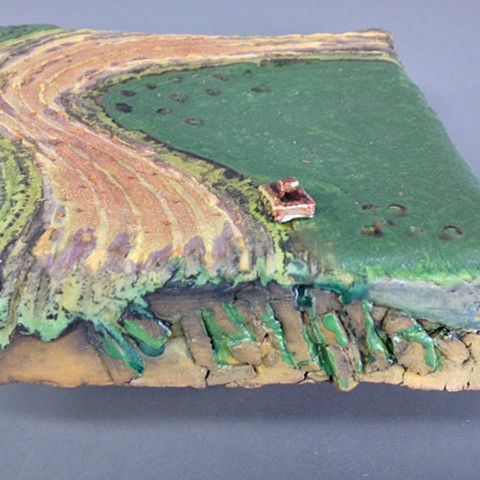 Handbuilt ceramic tiles for wall display. Aerial view.  Slice of land.