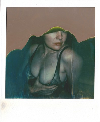 polaroid photograph, color photograph, erotic photograph