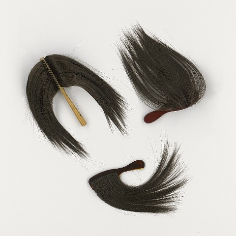 Conceptual Art objects of hair brushes & comb.