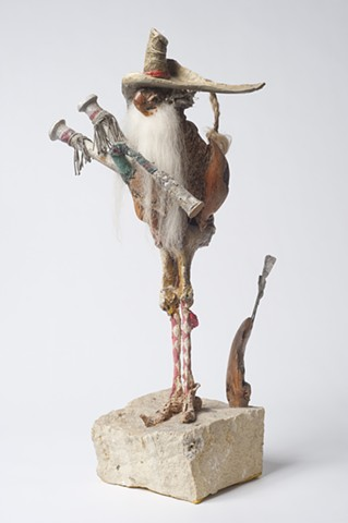 Scot with Bagpipe and Golf-Iron, 2000