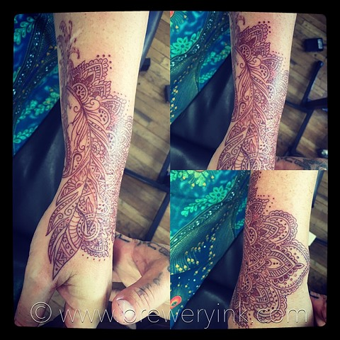 henna style feather hand tattoo
