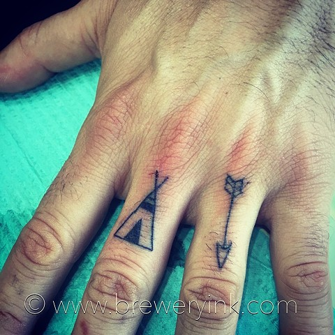 tipi and arrow finger tattoos