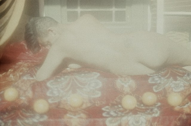 Reclining nude with oranges