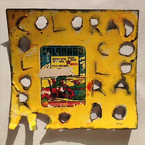 Yellow mixed media artwork on rag paper titled Colorado, one block in a State Quilt series of a large art installation